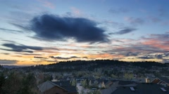 Time lapse of clouds over residential homes in Happy Valley, OR at sunset 4k UHD Stock Footage