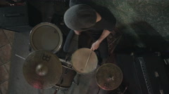 View from above of a rock drummer playing drums in a live concert Stock Footage