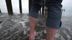 Beach point of view (POV) on a stormy day. - stock footage