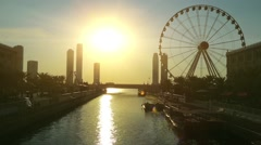 Al Qasba canal and ferris wheel in Sharjah city, United Arab Emirates Stock Footage