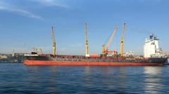 Pan shot of cargo container ship berthed in commercial sea port.  Stock Footage