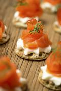 Smoked Salmon starter on a wooden table Stock Photos