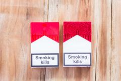 Pack of Marlboro Cigarettes on Wooden Table Stock Photos