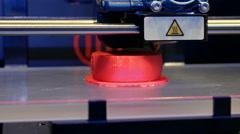 Three dimensional plastic 3d printer in laboratory - stock footage