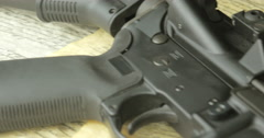 Pan Shot of an Assault Rifle on top of the United States Constitution Stock Footage