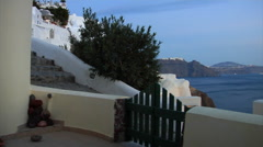Santorini Island, Greece. Panorama from a cave house patio at dusk. Stock Footage