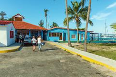 CIENFUEGOS, CUBA - MARCH 30, 2012: administrative buildings of marina Stock Photos