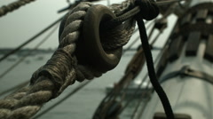 A close up shallow depth of field of  ropes masts and spars on a sailing ship Stock Footage