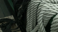 A right to Left panning shot of a sailing ship's ropes deck rail and floor Stock Footage