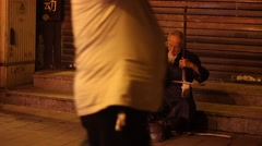 Street musician playing a traditional Chinese instrument Stock Footage