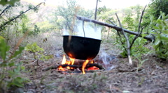 Bivouac. Cooking on fire during hike Stock Footage