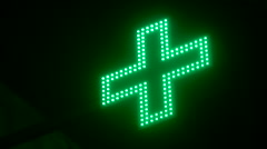 Flashing Green Cross on a Black Background Stock Footage