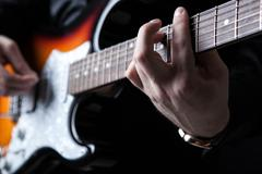 Guitarist playing guitar Stock Photos