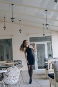 Very beautiful girl in a black dress - stock photo