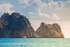 Beach of Cleopatra with sea and rocks of Alanya peninsula, Antal - stock photo