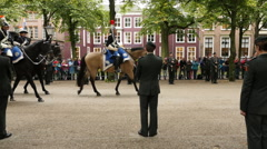 Horses Ride Past Soldiers Standing at Attention - The Hague Netherlands Stock Footage