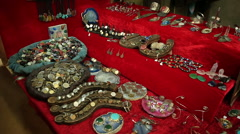 Showcase with coins and handmade ornaments in  a medieval market Stock Footage