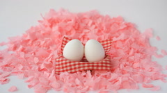 White Easter Eggs On A Pink Background Stock Footage