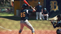 Batter hitting ball and running to first base during a baseball game. Stock Footage