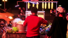 Backside Vietnamese Men Sell Street Fast Food at Night Stock Footage