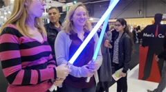 Two Girls Each Holding A Fake Lightsaber Star Wars Stock Footage