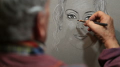 Artist paints a portrait of a woman in a medieval market Stock Footage