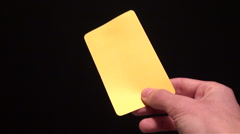 Soccer referee showing yellow card - stock footage