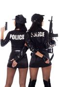 Two sexy women in police uniform. - stock photo