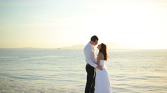 Happy bride and groom kissing on sea background. Honeymoon in Egypt - stock footage