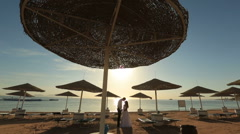 Silhouettes of wedding couple kissing on the beach. Honeymoon in Egypt Stock Footage