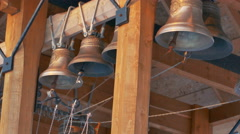 Bell Ringer Rings Bells at Church Belfry in Winter - stock footage