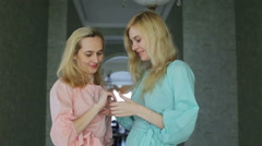 blonde sisters in beautiful dresses at home, showing wedding ring - stock footage