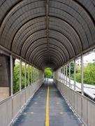 Walkway on footbridge - stock photo