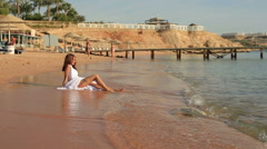 Groom and bride playfully having fun on the seashore. Sunny day in Egypt Stock Footage