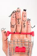 Funny fingers shopping at supermarket with red cart trolley on white background Stock Photos