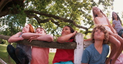 mixed race person of laughing children in a summer park - stock footage