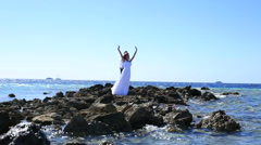 Wonderfull bride and groom posing on the stoned seashore in Egypt. Beautiful Stock Footage