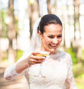 champagne in a hand of the bride - stock photo