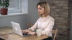 Woman work at laptop drink coffee and smile on the camera Stock Footage