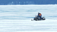Man Riding Snowmobile on Ice of Onego Lake, Karelia, Russia Stock Footage