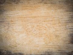 Wooden chopping board with scored surface texture Stock Photos