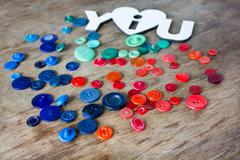 Many multi-colored buttons - stock photo