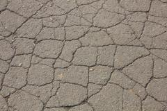 Very cracked asphalt Stock Photos