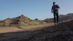 Morning jogging on hilly terrain - stock footage