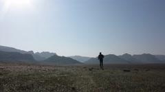 Silhouette of athlete running on sun valley - stock footage