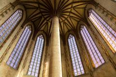 Pillar and colorful windows in Augustian convent Stock Photos