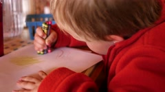 Little boy coloring while waiting for food at restaurant Stock Footage
