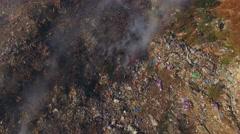 Huge Burning Waste Deposit Covered With Smoke - stock footage