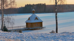 Small Wooden Chapel in a Sunny Snowy Winter Day - stock footage