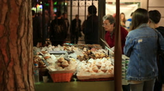 MURCIA, SPAIN-MARCHOld woman looking  at  the sweet cakes on showcase Stock Footage